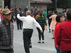 Line dancing in Chengdu's People's Park
