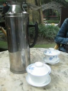 Flask of tea in Chengdu tea garden