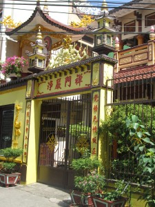 Temple opposite a yarn shop in Saigon