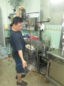 Preparing tea at Hua Mui cafe in Johor Bahru