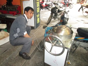 Mr Khoa roasting his coffee in Hanoi